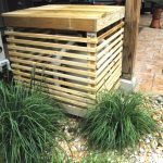 natural wooden pool filter cover design with wooden trim application upon pebble land with grass and concrete patio with wooden pole