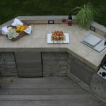 outdoor counter idea with cream natural stone surface with gas stove