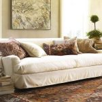 pottery barn sofa reviews in white fabric plus decorative cushions and modern rug for living room ideas with wooden end table