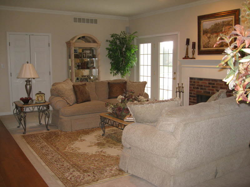 Rug On Top Of Carpet In Living Room With Comfy Lovesat And Vintage Coffee  Table And