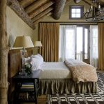 Rustic Bedroom Idea With Logs Ceiling Old Look Metal Pendant Chandelier Black Stained Wood Bedside Tables With Table Lamps Bedroom Rug Two Layers Of Window Curtains Tree Trunk Pillar Idea