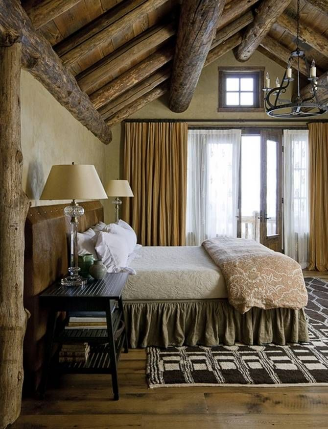 Rustic Bedroom Idea With Logs Ceiling Old Look Metal Pendant Chandelier  Black Stained Wood Bedside Tables