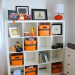 simple and lovable expedit storage bins design with orange accent around white color on wooden floor with green rug