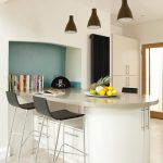 small and minimalist bar design in white theme two minimalist bar chairs three units of pendant lamps in black color