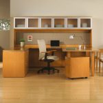 spacious office design with beige wooden modular desk components design with white upholstered leather chair and storage and wooden floor