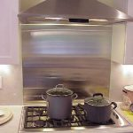 stainless steel backsplash gas stove two cookware