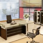 stunning brown modular desk for modern officewith glass top aside large storage with stylish swivel chair
