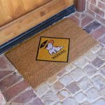 stunning brown personalized dog mat design with warning mark in yellow diamond shape pattern with cute dog photo on brick flooring design