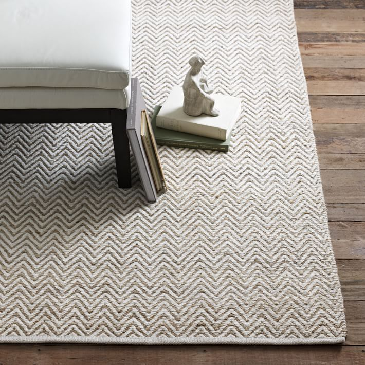 Stunning White Washed Flooring Idea With Gray Chevron Patterned Jute Rug Sofa And