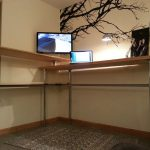 super large standing desk design with tall pole and wooden tops in different height with tree mural on the wall
