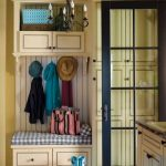 tiny mudroom storage units with built in bench plus drawer underneath plus striped mat and chandelier and glass door plus tile for flooring