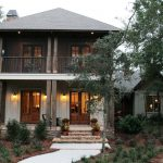 Traditional Charleston Style House Plans With Glass Wooden Front Door And Garden Plus Wallscones And Wooden Wall