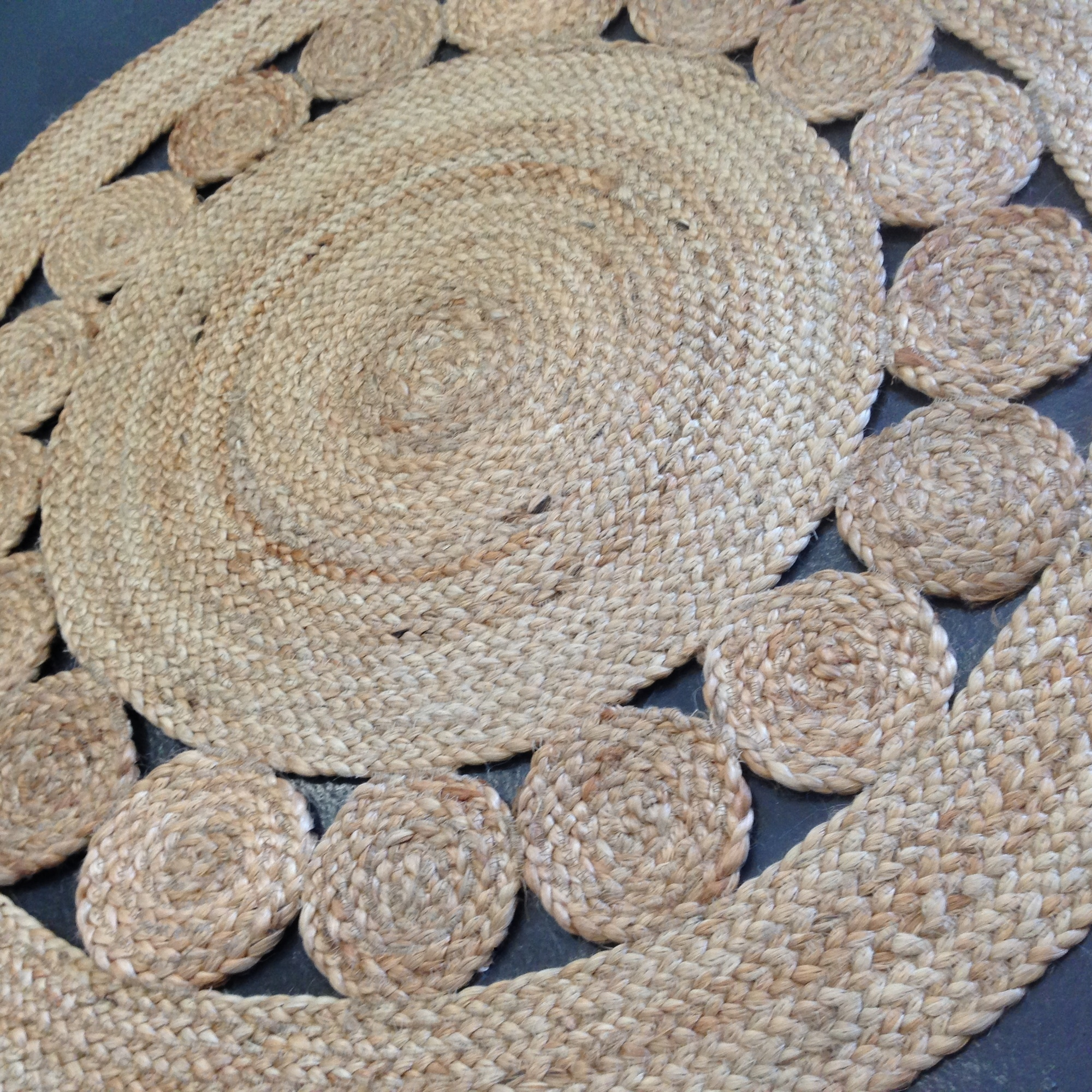Unique And Artistic Round Shaped Textured Jute Rug Idea With Pattern Chevron For