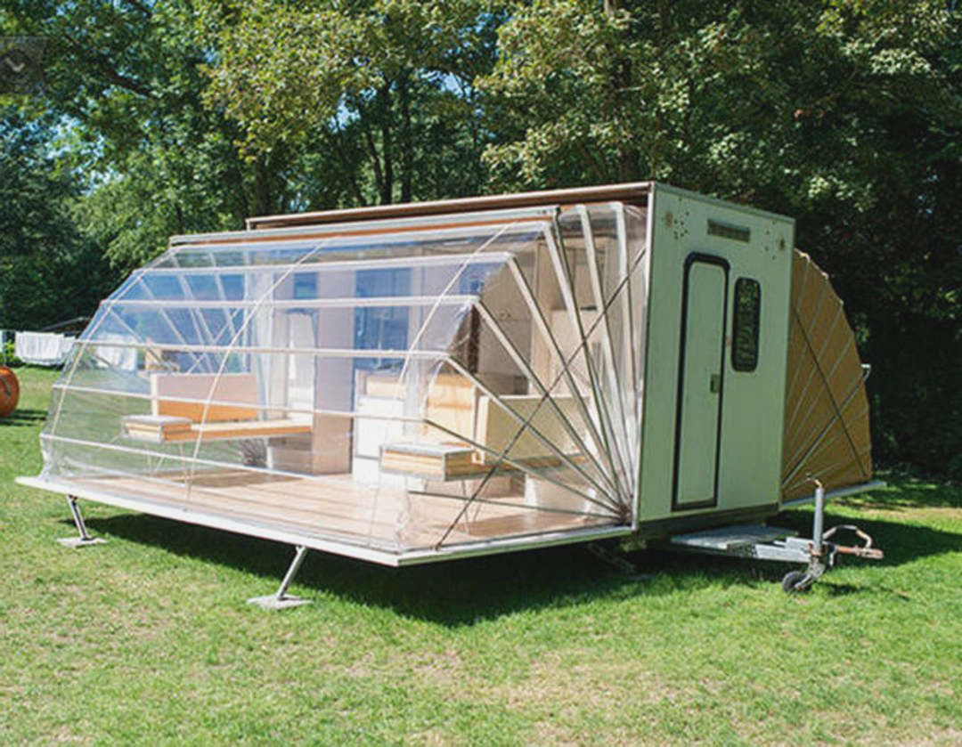 unique-designed-mobile-home-that-looks-like-house-with-fan-style-of-transparent-roof-on-grassy-meadow-beneath-lush-vegetation.jpg