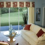 valances for sliding glass doors window treatment with natural curtain panel in livingroom with comfy couch with brown cushions and glass top coffee table and end table