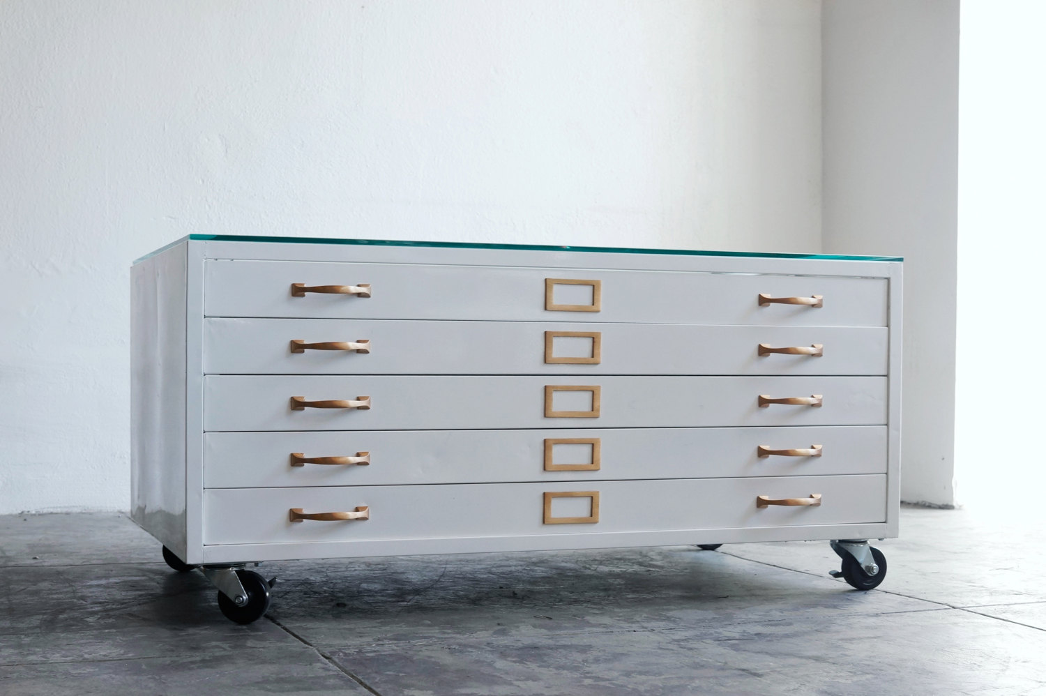 Vintage White Flat File Cabinet From Ikea Design With Golden Accent With  Wheels On Concrete Floor