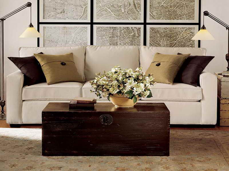 ... pottery barn couch with silky cushions beneath froted glass wall