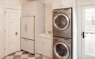white laundry room idea with white wooden cabinetry with stainless small combo washer dryer design aside glass door with plaid flooring