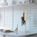 white tall mountain track aside white wall with toys hanger and little monkey from skandinavia furniture austin