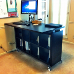 wonderful black wooden ikea stand up desk design with many storages and large countertop and large glass window with drape and wall board