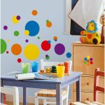 Wonderful Kindergarden Classroom With Beige Storage And Toys And Colorful Chairs And Navy Blue Table And Playful Glass An Washable Paint For Wall