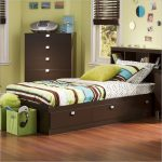wonderful wooden children twin beds with storage idea with stripe patterned sheet and green furniture aside tall chest of drawer on yellow wall