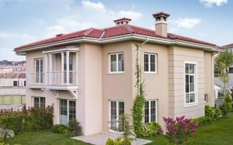 wondrous modern luxurious house design with bar window and red roof and chimney and tower and green back front yard and with the most popular exterior house color of cream