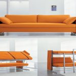 yellow couch that turn into bed design with section with cushions in spacious living room with large glass window