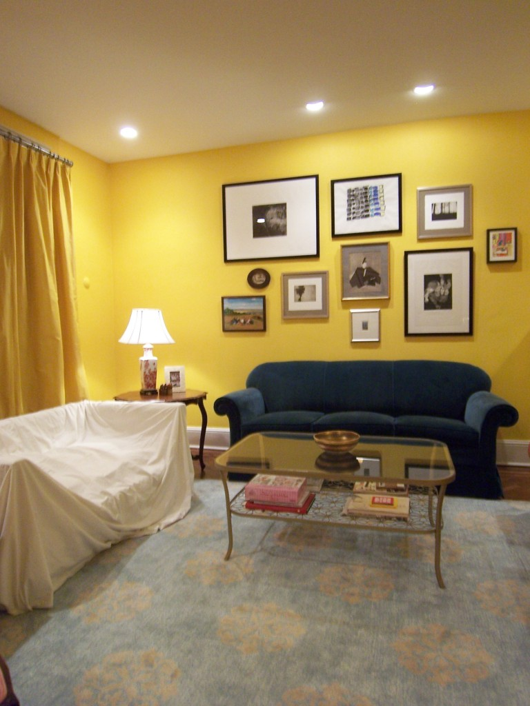 Yellow Interior Paint Ideas Part - 18: Yellow Paint Color Idea With Picture Frames Dark Blue Sofa A Console Table  Classic Table Lamp