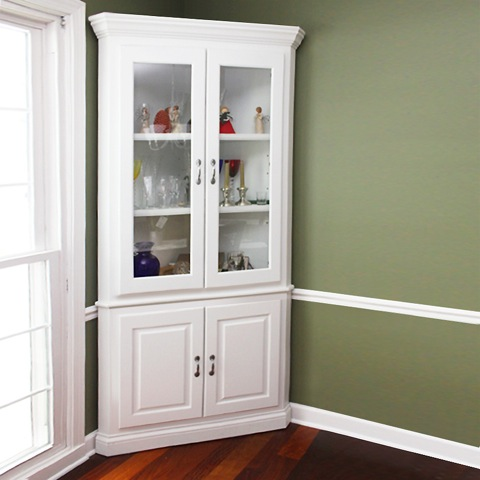 corner hutch storage idea with white stain and glass door