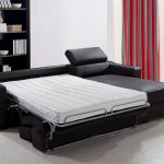 A sofa bed witha additional bed