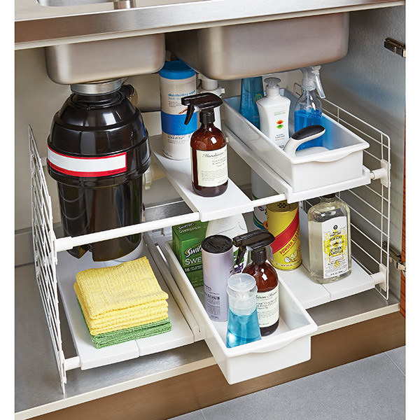 A White Metal Wire Rack With Bo For Storing Linens And Bottled Bathing Supplies Arrangements Of Storage Under Bathroom Sink Cabinet