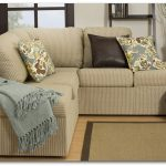Armless sectional sofa in light brown color dark brown throw pillows and floral patterned throw pillows smooth jute area rug for living room