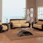 Armrest chairs with brown cushions glass top coffee table brown wool area rug bamboo floors idea