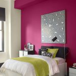Beautiful deep pink wall paint white wall paint white bed furniture green and white bedcover green pillow and black pillows black headboard minimalist bedside tables pink bedroom rug