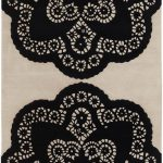 Beautiful floral patterned area rug in white and black color scheme by Thomas Paul