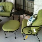 Beautiful metal chairs with green cushion and pillow a round metal table with green cushion  a round metal side table in black stain