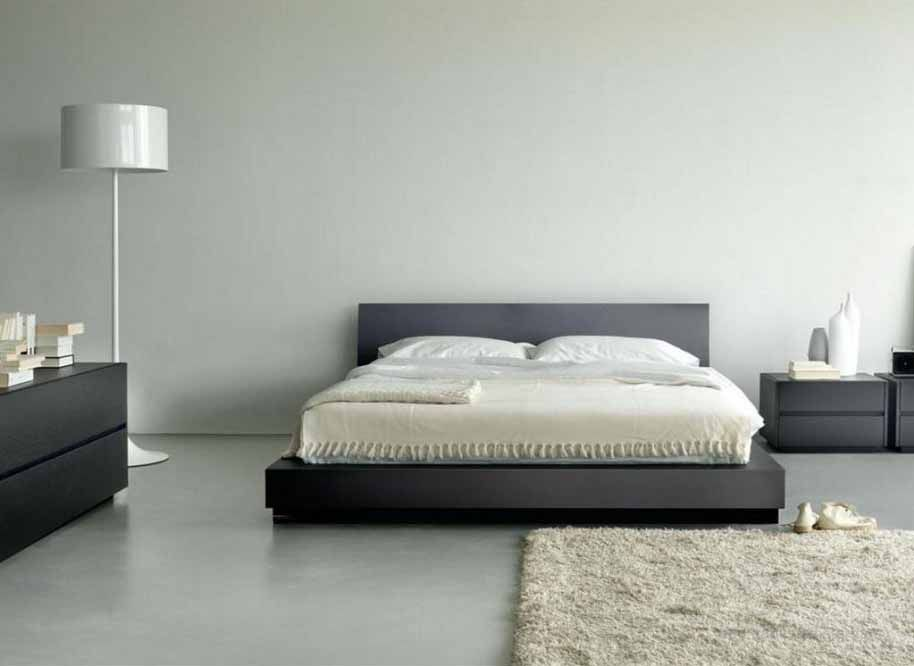 Black Minimalist Platform Bed With Headboard Black Minimalist Bedside Table  A White Standing Lamp Black Minimalist