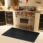 Black rubber mat for under gas stove area a modern kitchen set with black paint kitchen cabinets cream ceramic tile backsplash