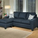Blue dark reversible sectional sofa with polka dots throw pillows jute rug for wood flooring round glass side table with table lamp