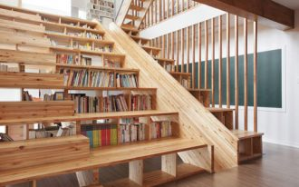 Bookcases under the wooden stairs