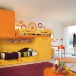 Bright yellow loft bed with storage and closet orange cabinet system as the additional storage system cool reading chair round rug purple bedroom rug