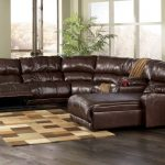 Brown leather reclining sectionals with single chaise a small area rug in light and deep brown color scheme