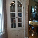 Built in corner hutch storage for a dining room