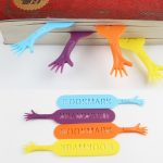 Colorful paper dividers or bookmarks in hands shape