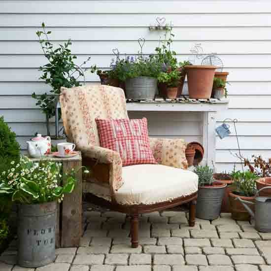 Country Garden Idea With An Arm Chair Pillow Rustic Side Table Mini In Pots
