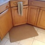 Cream rubber kitchen mat placed in the corner of kitchen area