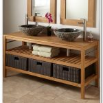 Dark rattan boxes storage under bathroom vanity shelves