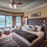 Eklektik Interiors decorator Houston for elegant unique modern bedroom with natural color scheme wooden floor leather bed head