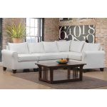 Elegant white sectional sofa with pure white throw pillows wooden coffee table modern chalkboard decoration on wall red brick wall system a grey rubber area rug
